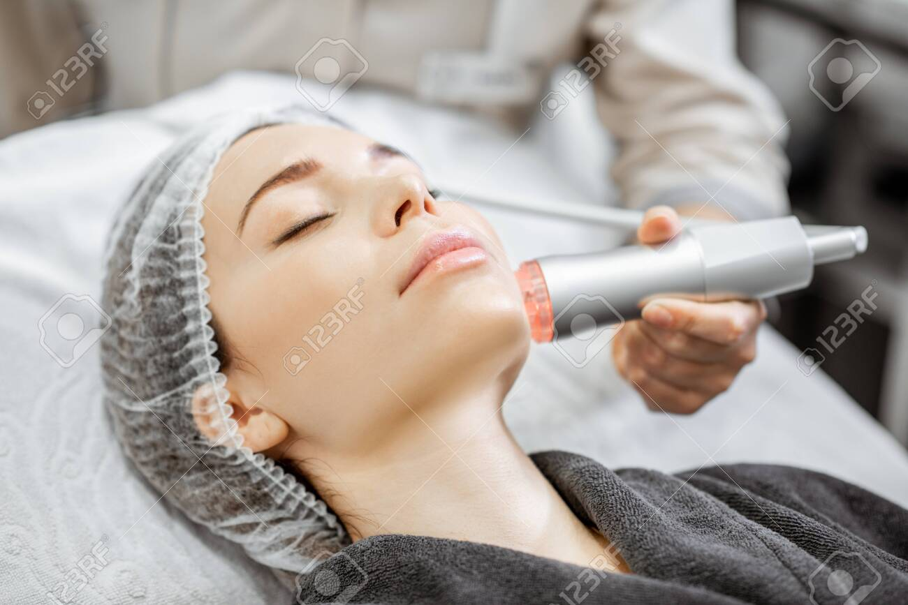 Woman during the oxygen mesotherapy procedure at the beauty salon, close-up view. Concept of a professional facial treatment - 132048719