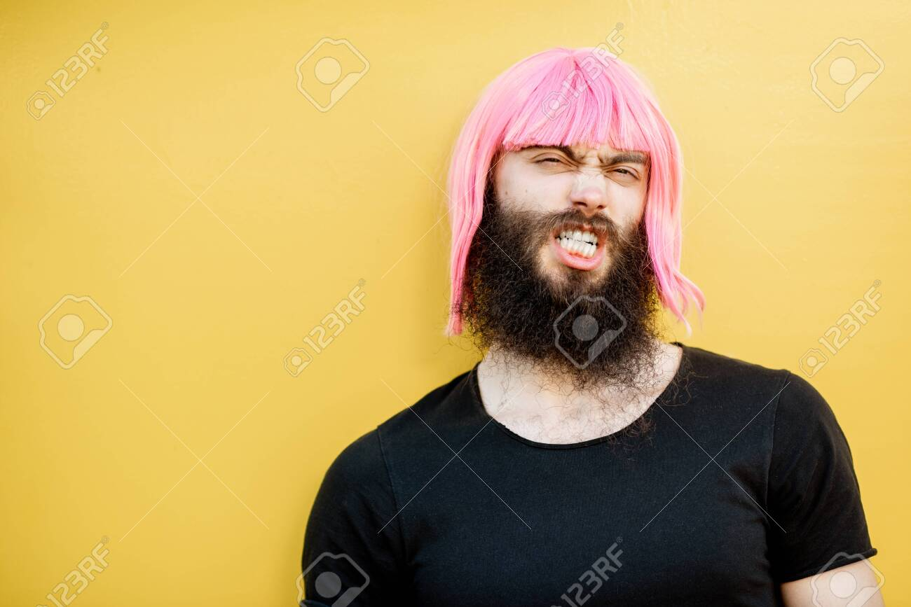 Funny Portrait Of A Stylish Playful Man With Beard And Long Color