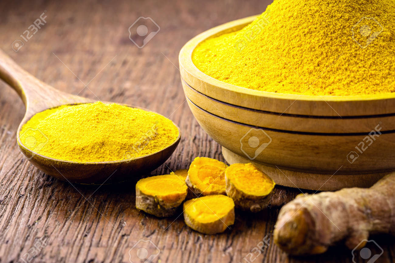 spoonful of turmeric powder, Indian culinary spice - 166242442