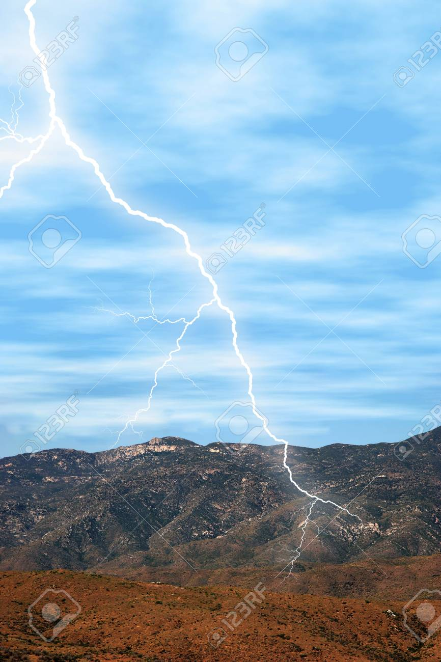 Lightening striking in the desert mountains. Stock Photo - 336579