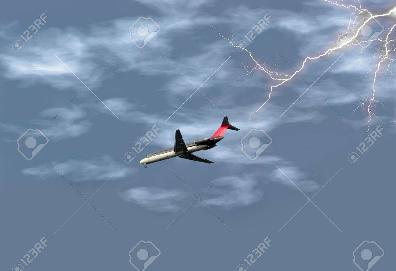 Airplane getting ready to land in the midst of a lightening storm. Stock Photo - 567546