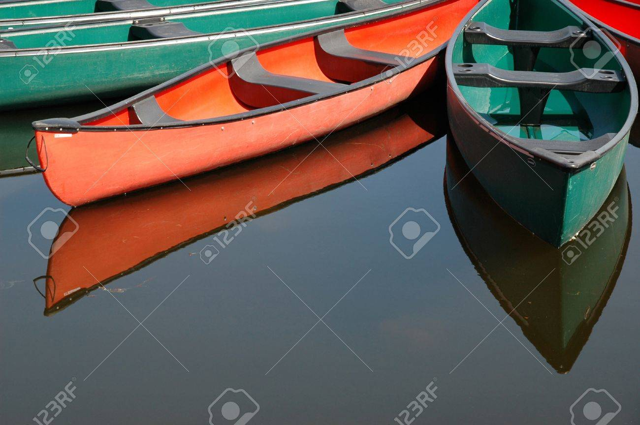 Rental canoes tied up at wharf at the pavilion on Dows Lake in central Ottawa, Ontario, Canada Stock Photo - 10943211