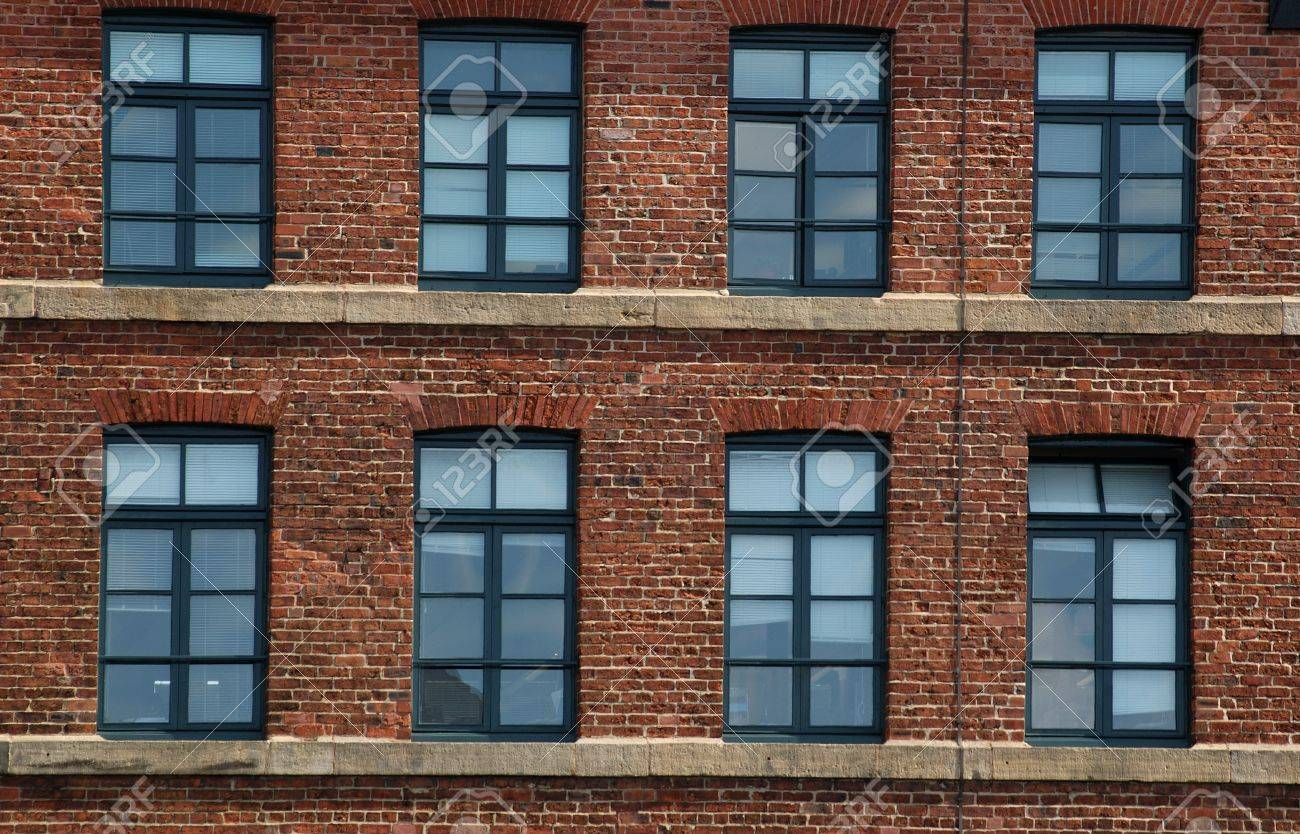 Brick Apartment Building Window windows and brick in an old industrial building near the royal