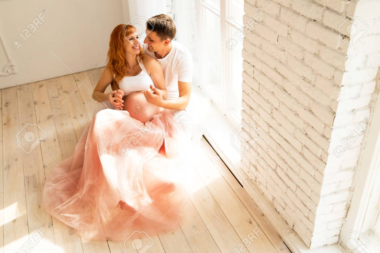 bd0938a35951a Pregnant Woman In A Tulle Skirt And Her Husband Stock Photo, Picture ...