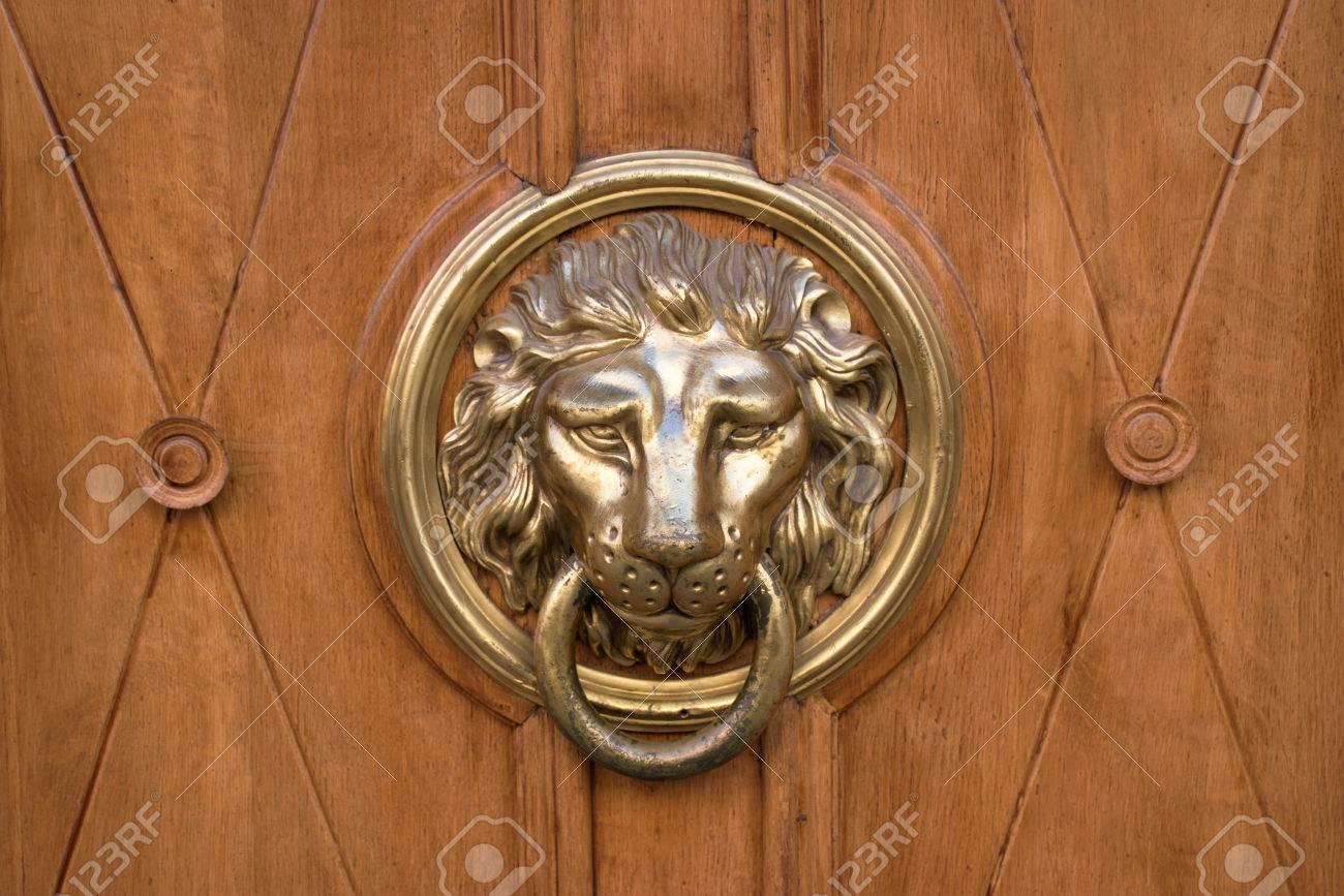 Antique lion door knocker on a wooden door Stock Photo - 31593635 - Antique Lion Door Knocker On A Wooden Door Stock Photo, Picture And