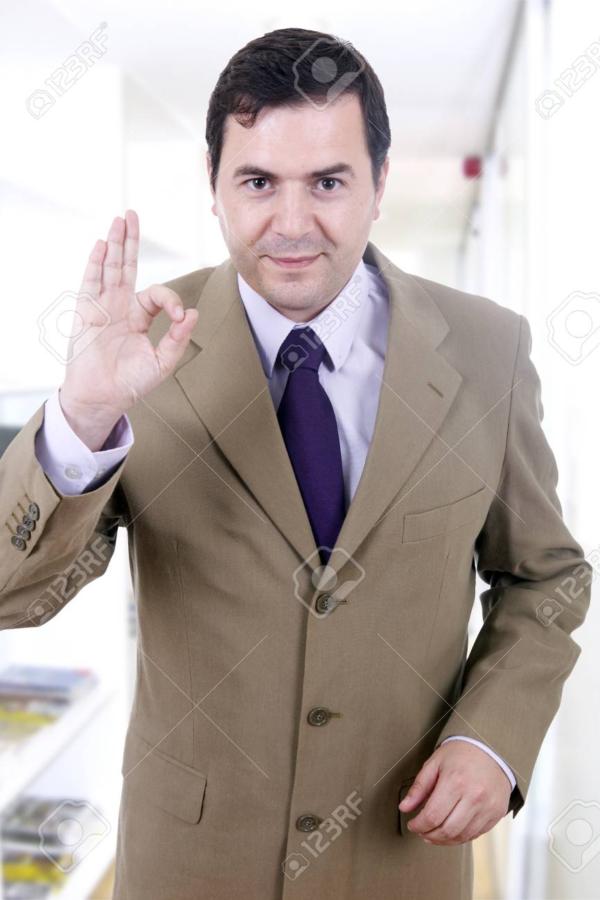 A young handsome happy business man gesturing success at office building Stock Photo - 17071014