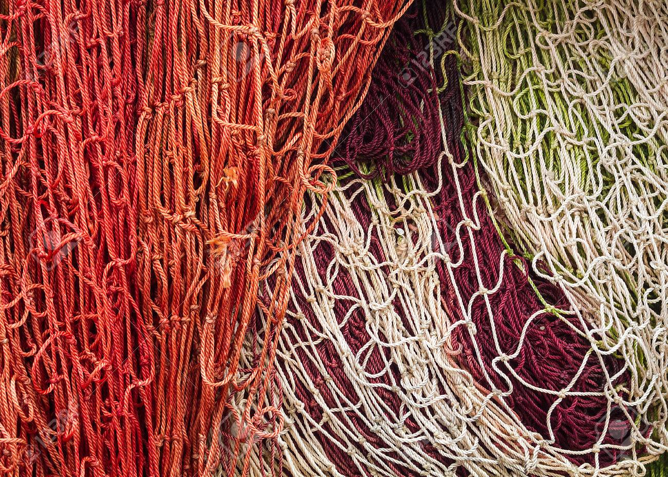 Close-up of fishing nets stacked in the harbor, paying particular..