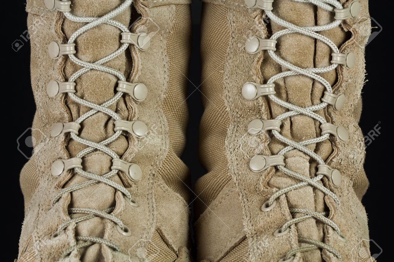 Close-up Of Tan Leather Army Combat Boot Laces On Black Background ...