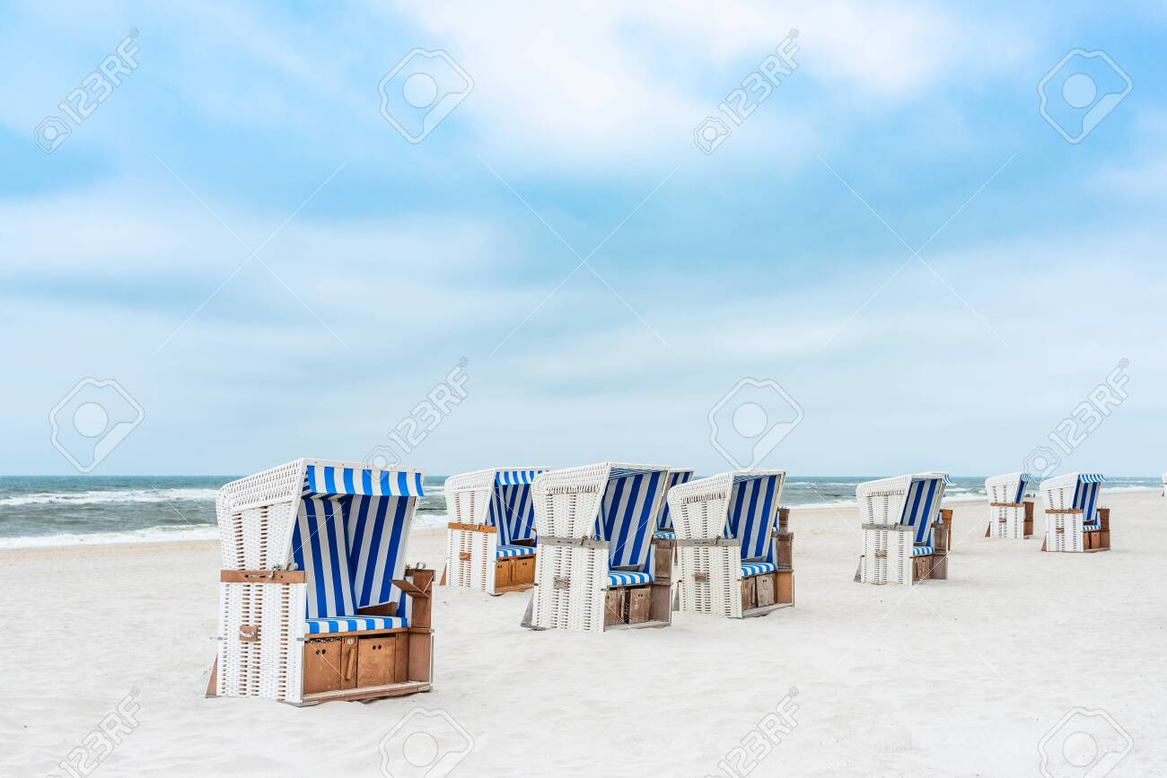 Beach Chairs On The Island Sylt Vertical Germany Stock Photo