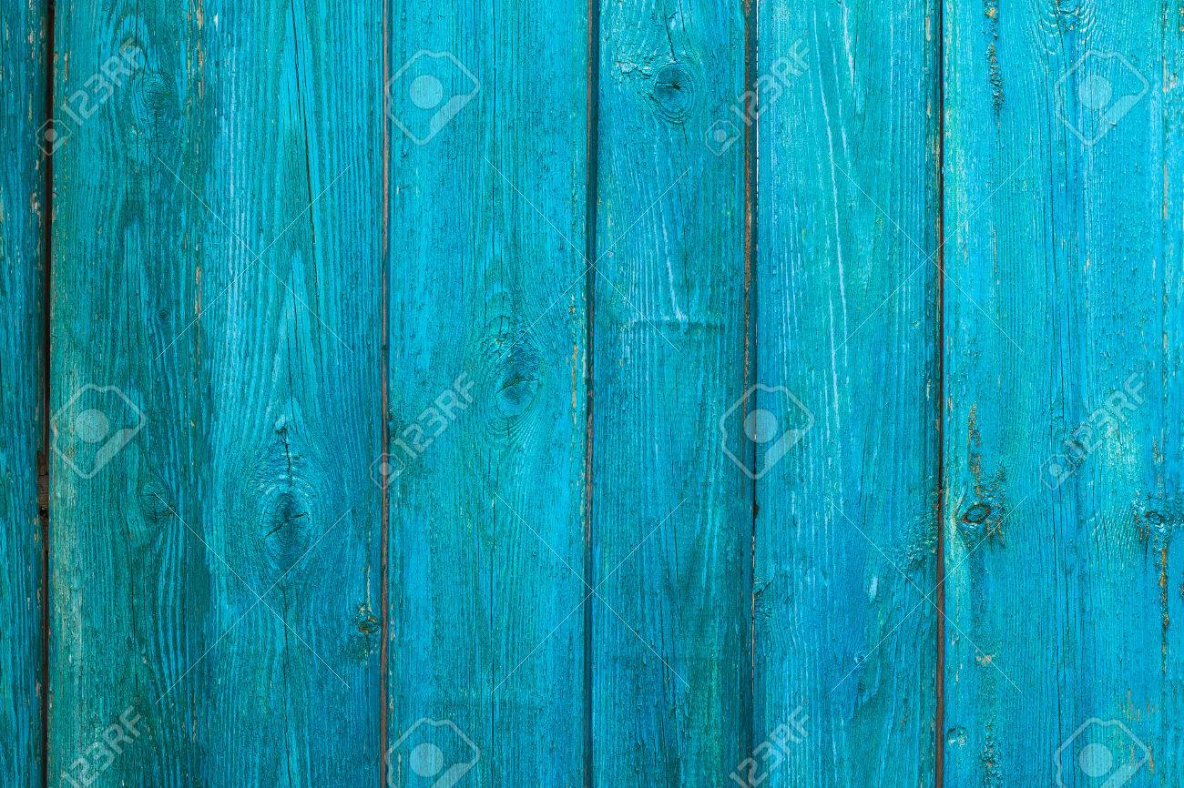 Vintage Wooden Texture Of An Old Fence Painted Blue Vertical