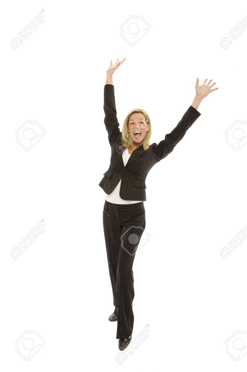 Businesswoman in a suit raises her arms in triumph Stock Photo - 1229078