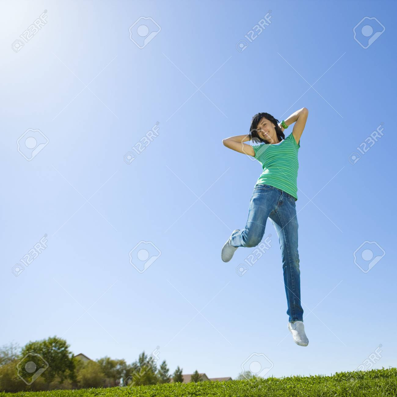 Happy teen jumps in air Stock Photo - 3569512