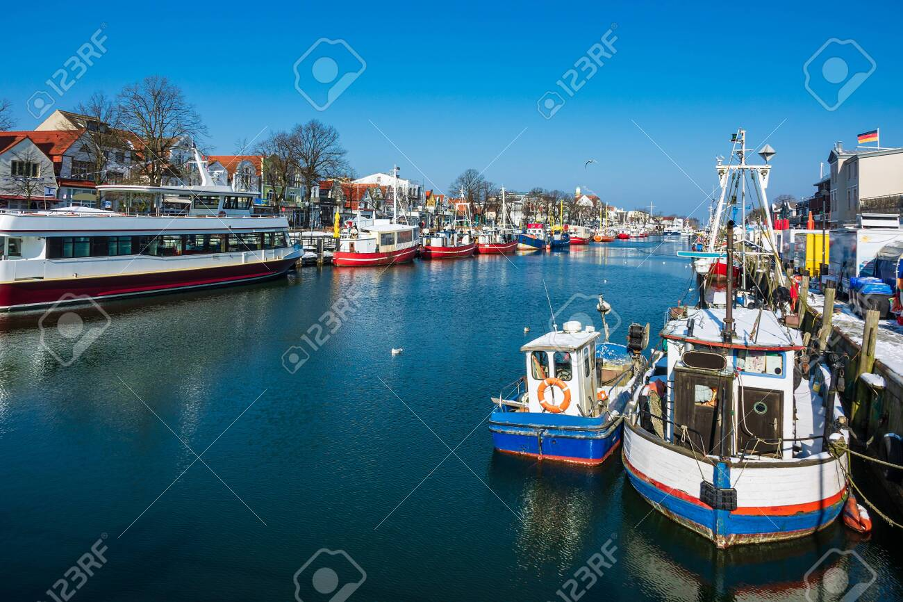 Fishing boats in winter time in Warnemuende, Germany. - 151782362