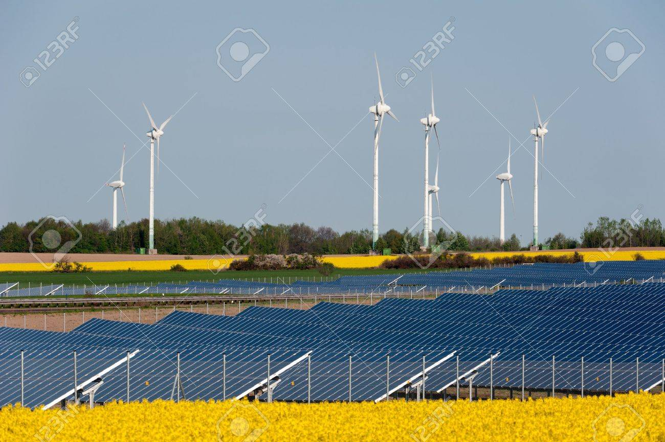 Wind turbines and solar panels in a rapeseed field Stock Photo - 13530930
