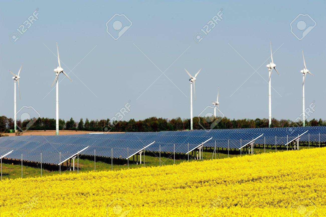Wind turbines and solar panels in a rapeseed field Stock Photo - 13530933