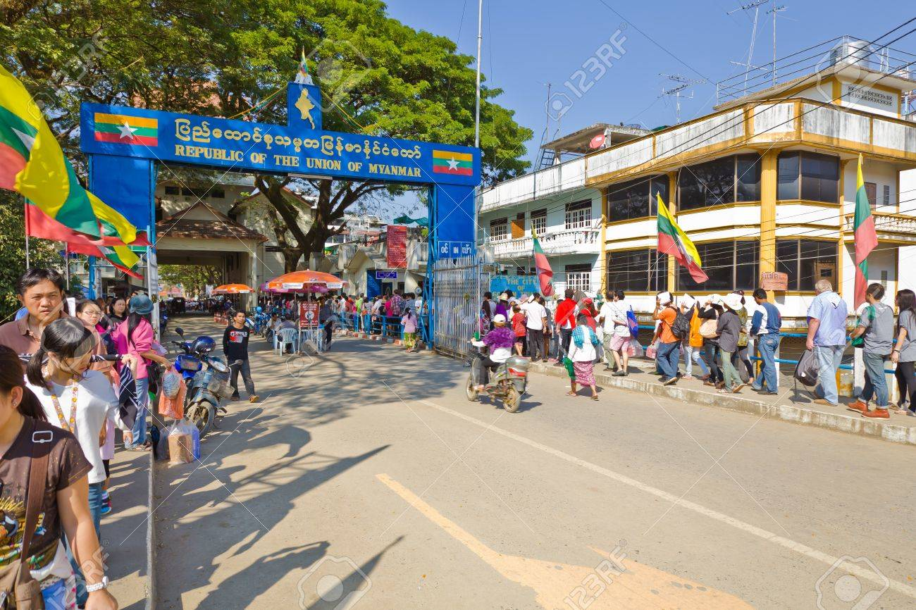 CHIANG RAI PROVINCE, THAILAND - JANUARY 2: Unidentified group of tourists are traveling to the boundary post of Republic of the Union of Myanmar on January 2, 2012 in Maesai District, Chiang Rai province, Thailand - 12257453