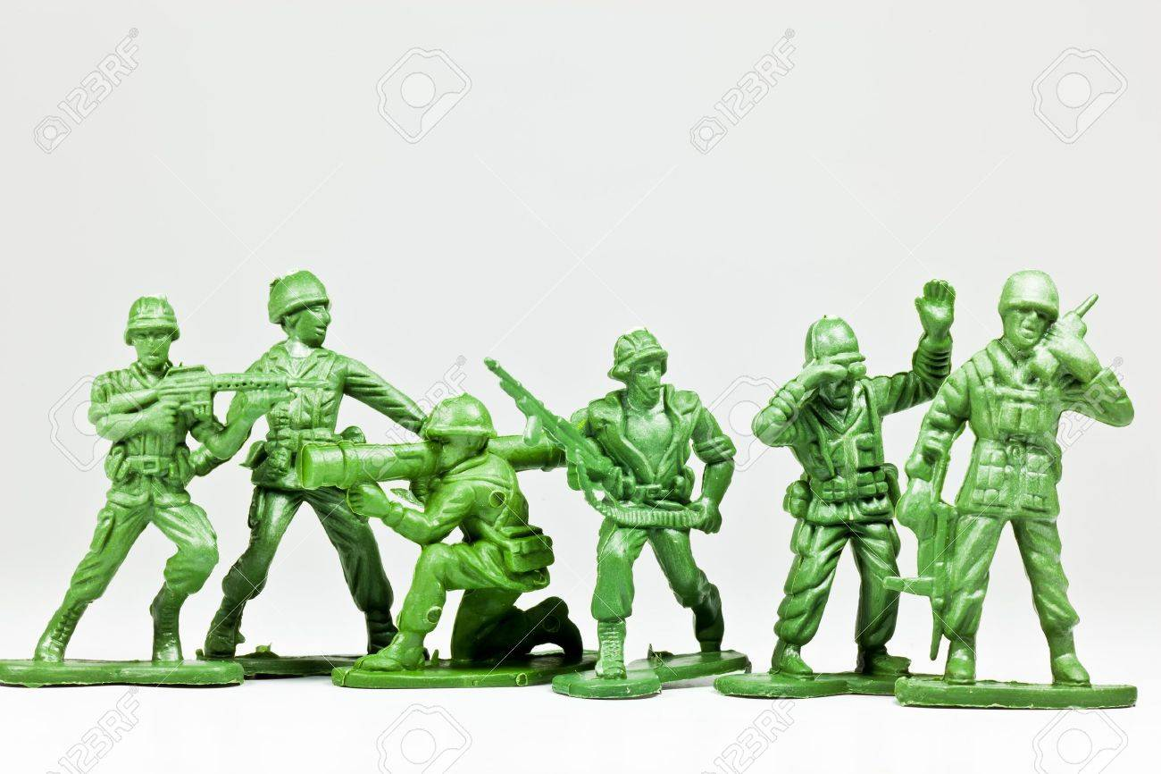 The isolated image of a group of green plastic toy soldiers - 13174561