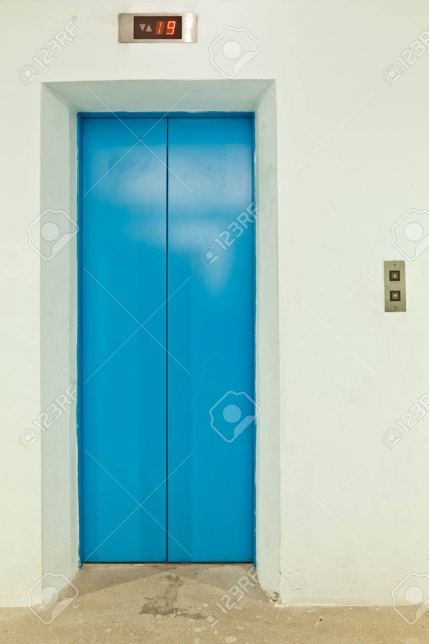 The front elevation of a blue metallic doorway of an elevator - 15721626