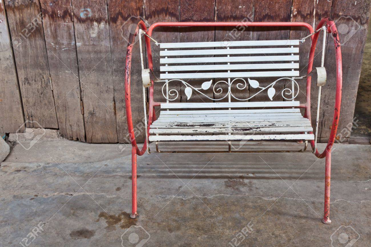 The old swing in front of the old wooden partition of a shophouse - 16801969