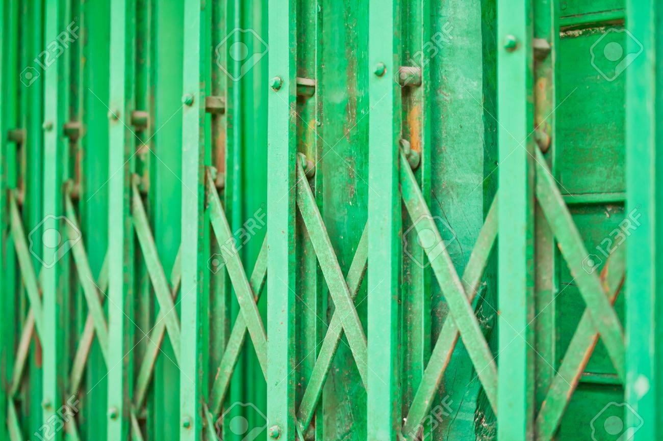 The closeup image of the green metal shutter gate - 16801963