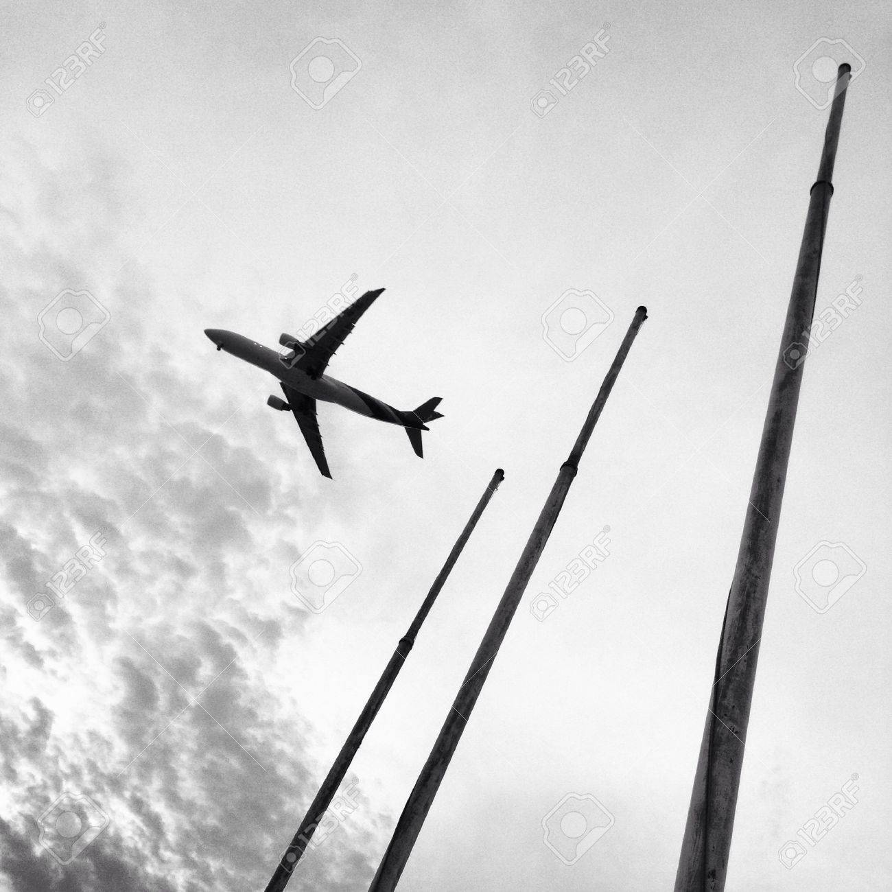 plane is flying over poles - 21341854