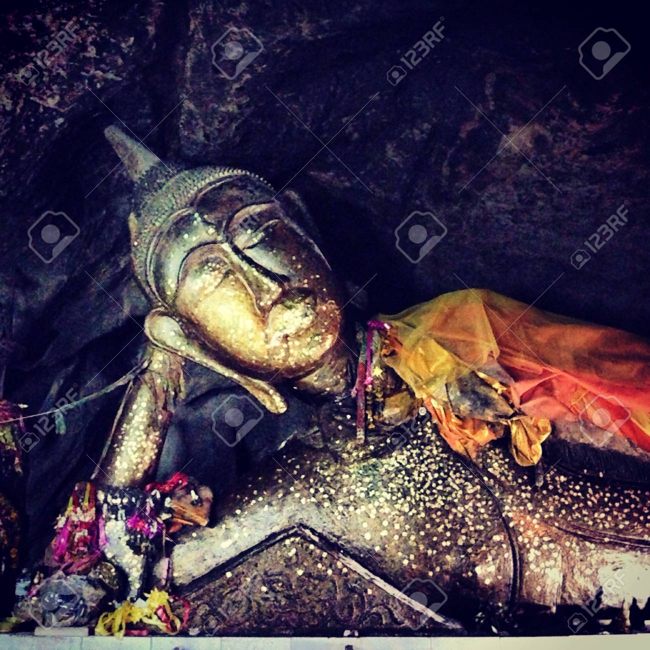 The image of sleeping Buddha in a cave of Thailand - 21661726