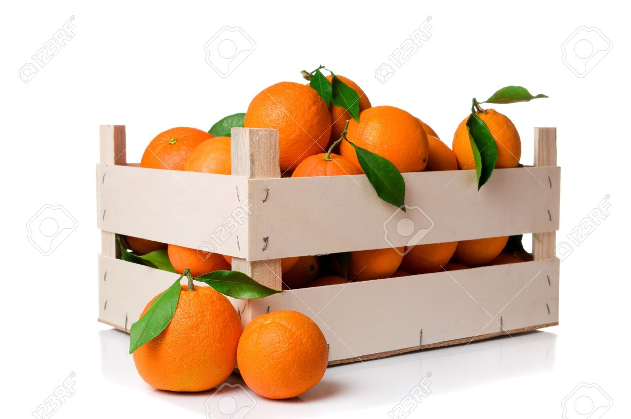 Fresh And Ripe Orange Fruits With Leaves In A Wooden Crate Isolated On White Background Stock