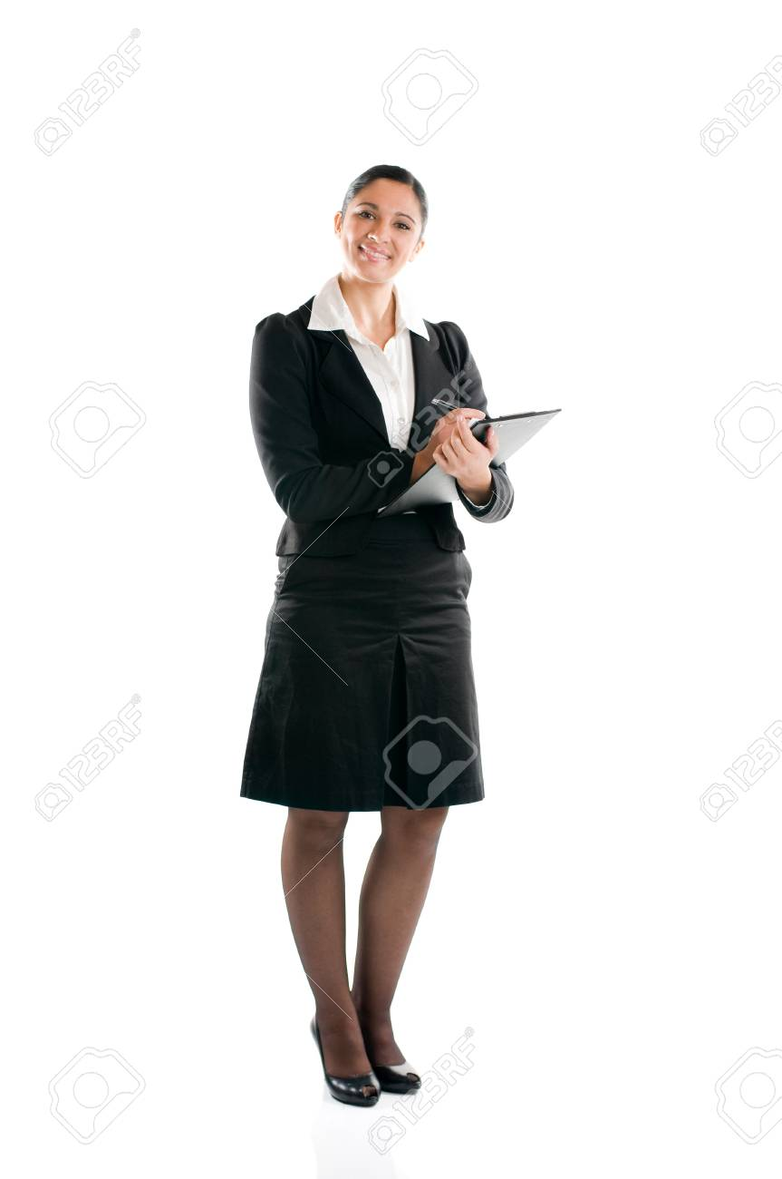 Full length young business woman taking notes on her clipboard isolated on white background Stock Photo - 8234445