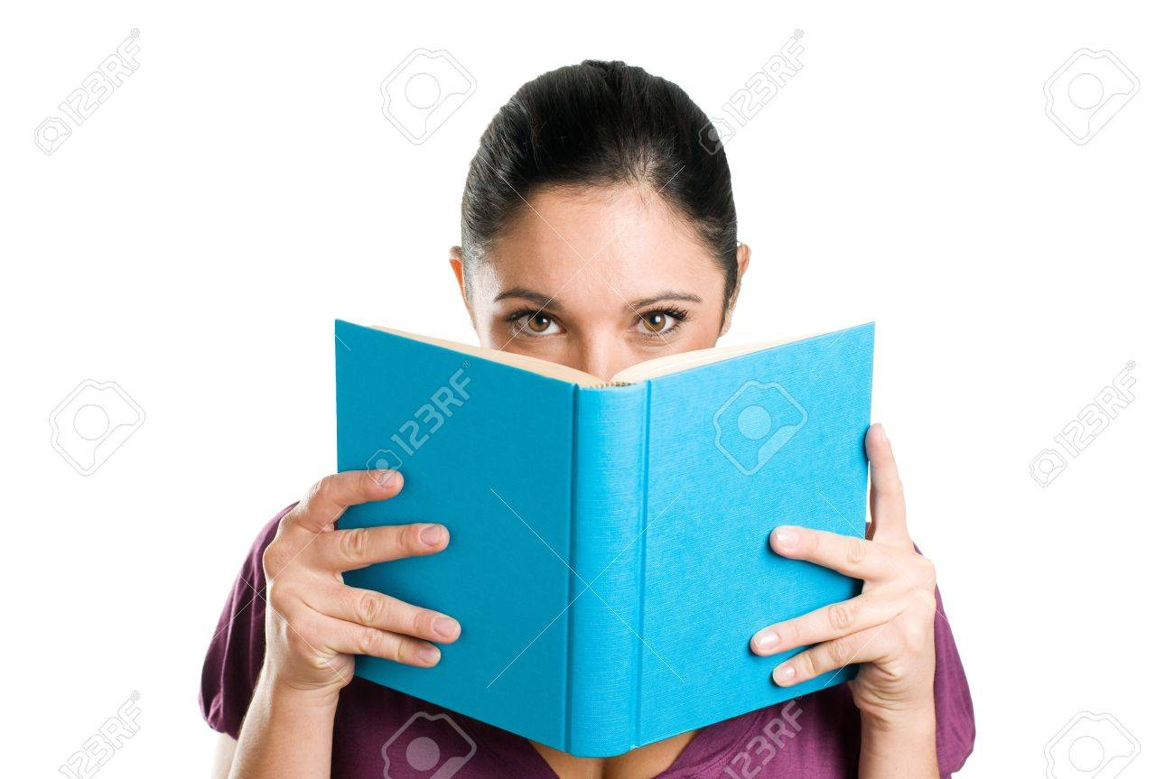 Beautiful young casual woman hiding herself behind a book isolated on white background Stock Photo - 8235239