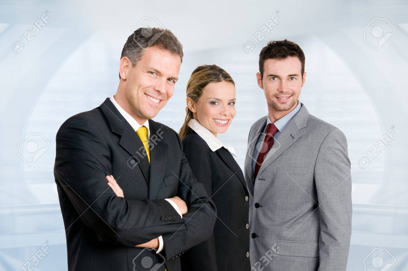 Three happy business colleagues standing together and looking at camera in their modern office Stock Photo - 8236109