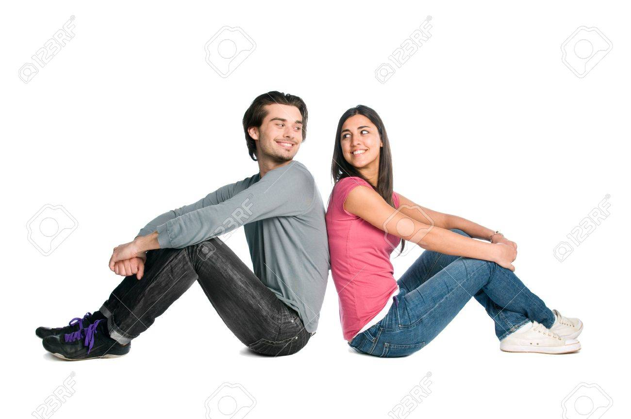 Smiling young couple looking each other with tenderness and love isolated on white background Stock Photo - 8235640