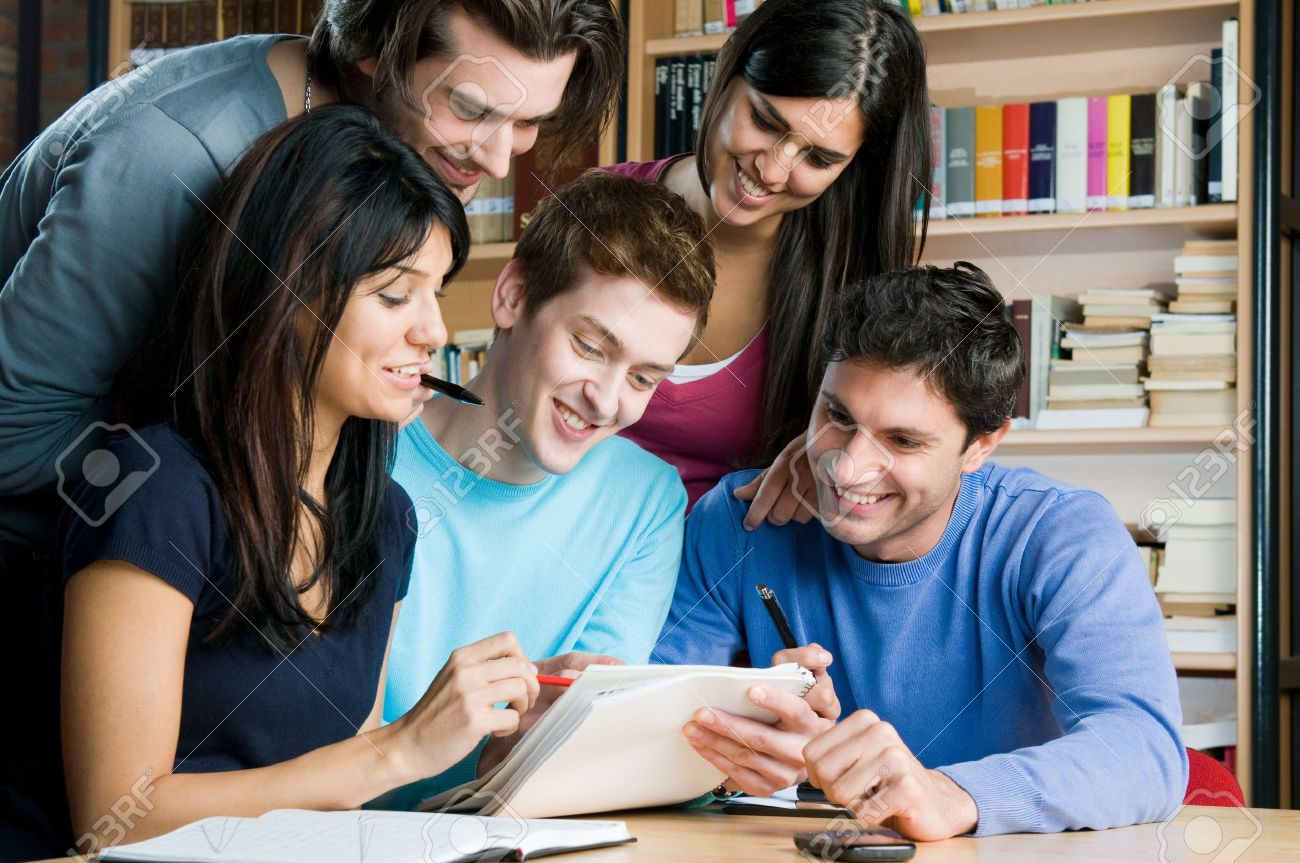 happy group of students studying and working together in a college happy group of students studying and working together in a college library stock photo 8236171