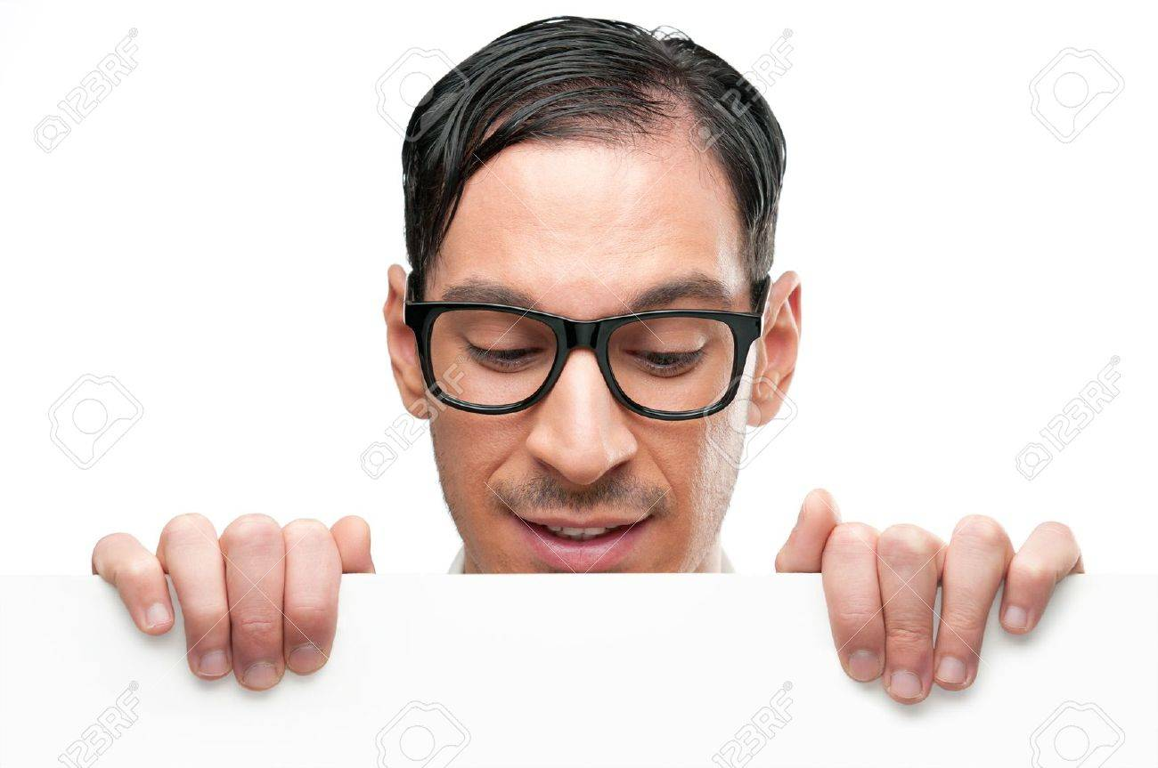 Happy nerd holding white placard for your text and looking down at it isolated on white background Stock Photo - 8589927