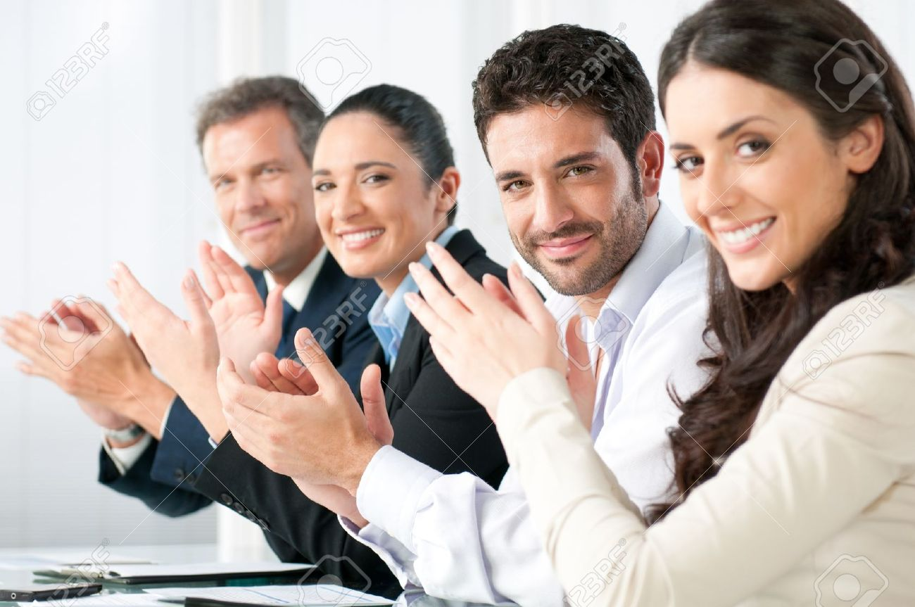Satisfied proud business team clapping hands and looking at camera in a modern office - 8590040