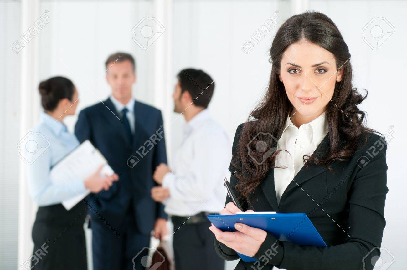 Satisfied smiling business woman compiling a form for a job recruitment or interview at office Stock Photo - 8590022