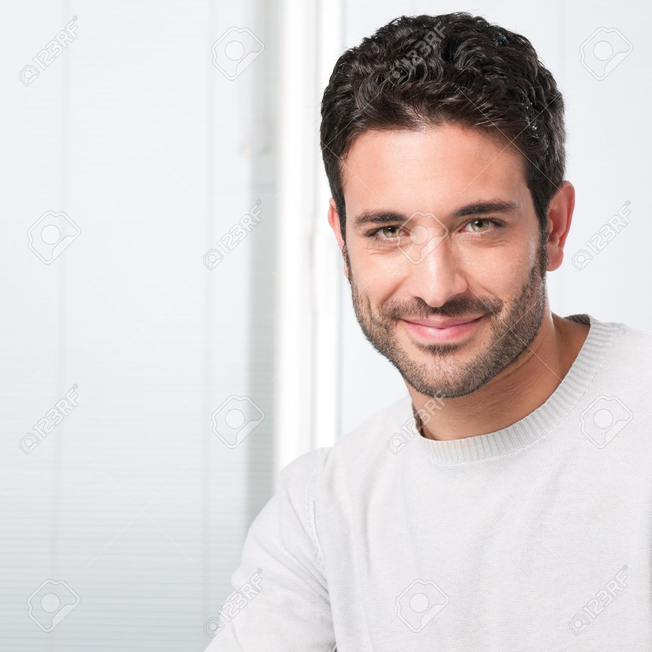 Happy smiling guy looking at camera with satisfaction Stock Photo - 8589931