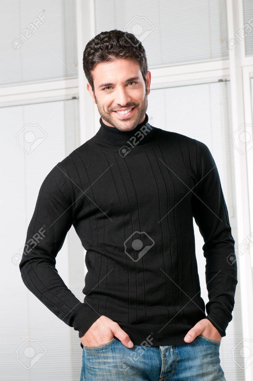 Happy smiling young man looking at camera with satisfaction Stock Photo - 8590282