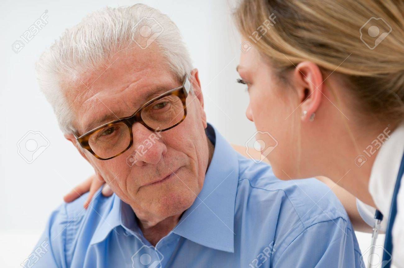 Sad and lonely senior man with nurse Stock Photo - 10044367