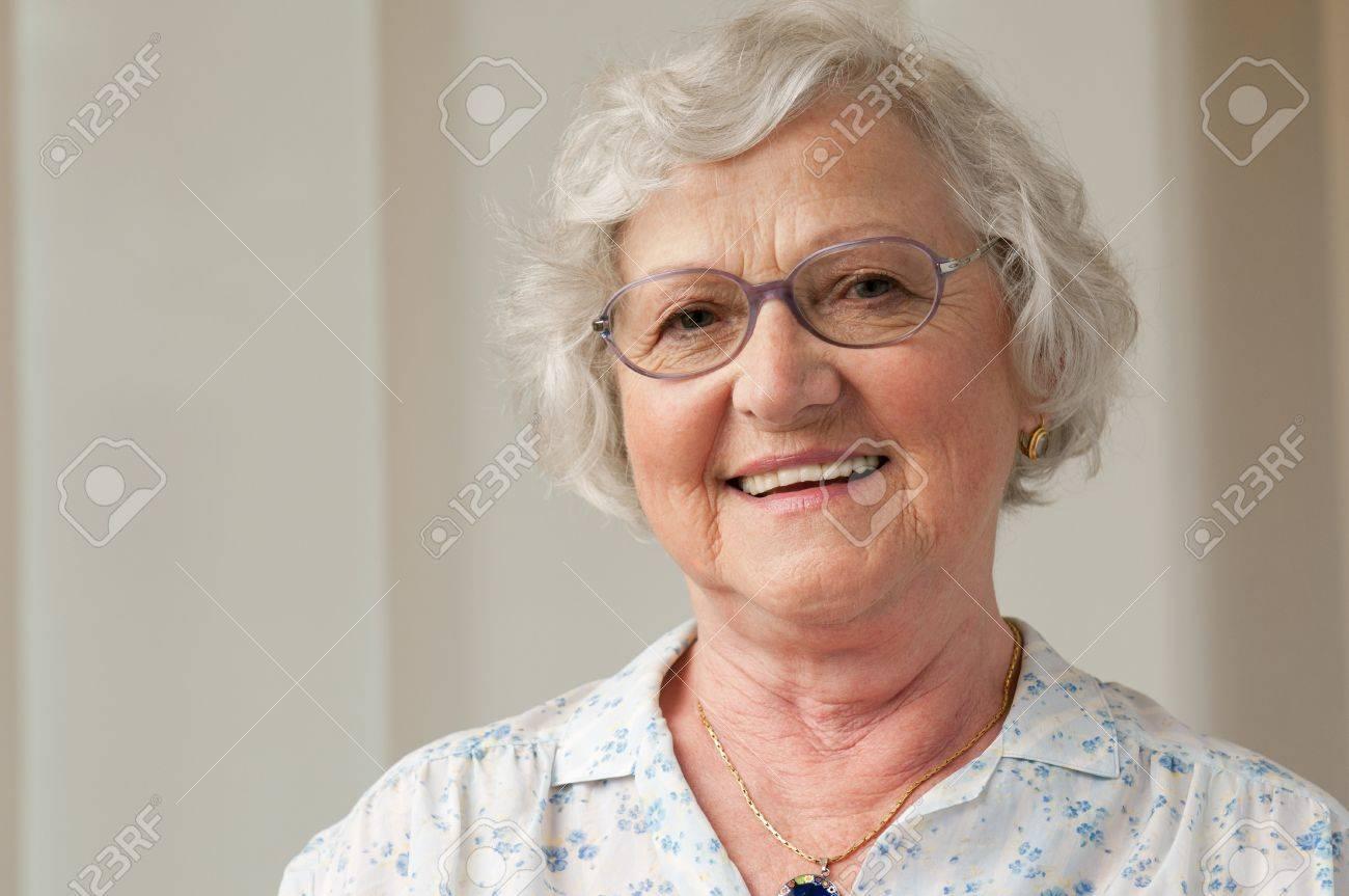 Happy smiling senior woman looking at camera at home Stock Photo - 10044374