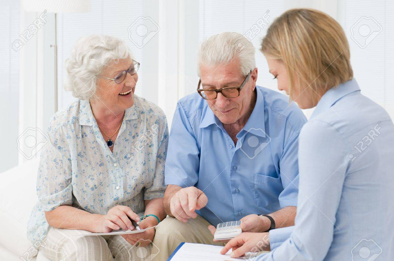 Retired old couple planning their investments with a financial consultant Stock Photo - 10562954