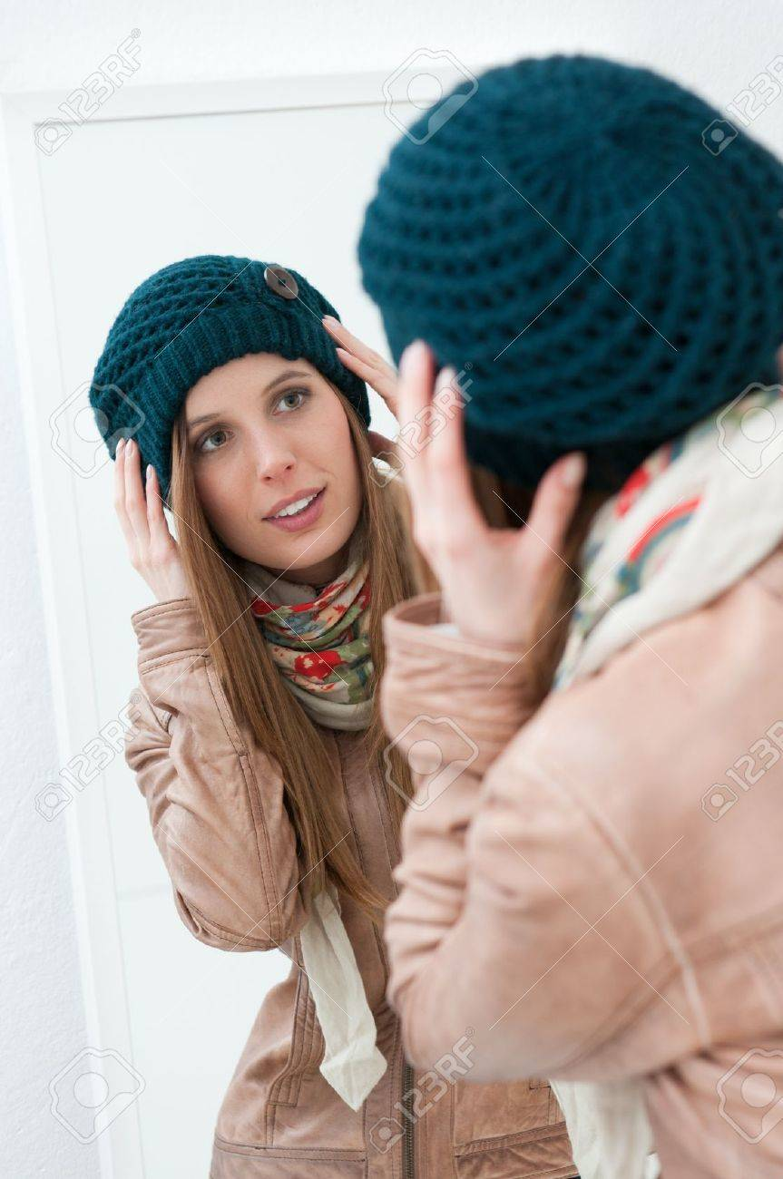 Young beautiful lady trying winter clothes in front of a mirror Stock Photo - 11742954