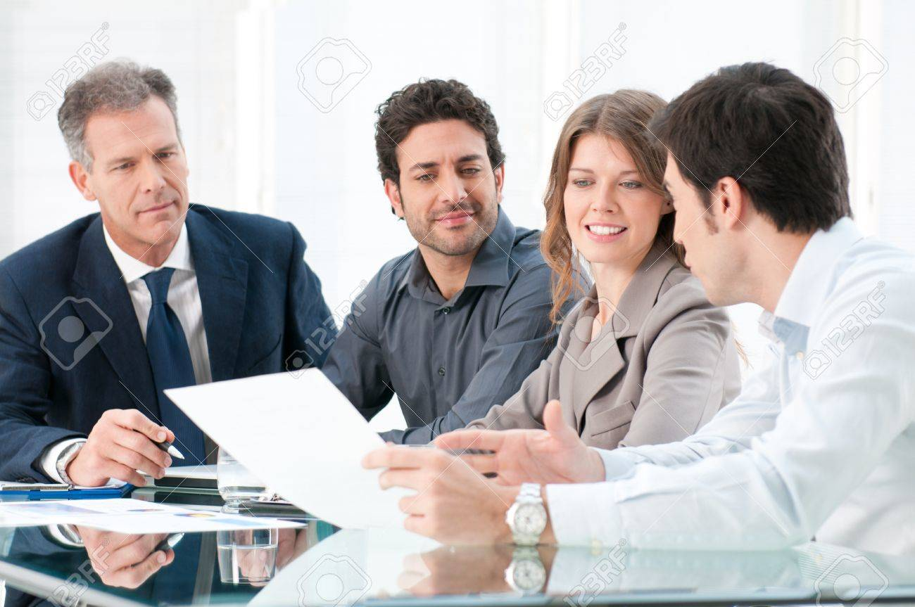 Dedicated business people discussing together thair strategy at office Stock Photo - 12155608