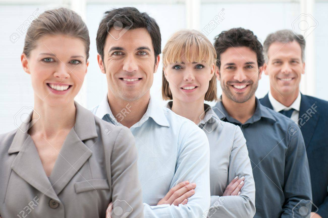 Happy smiling business team standing in a row at office Stock Photo - 12669546