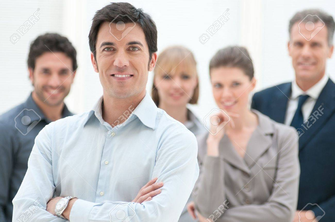 Proud smiling businessman standing with his colleagues at office Stock Photo - 12669536