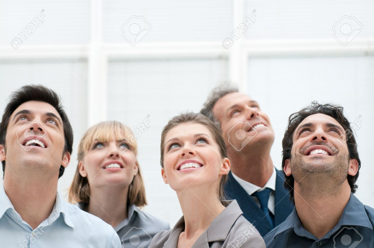 Happy positive business group looking up with dreaming expression Stock Photo - 13025769