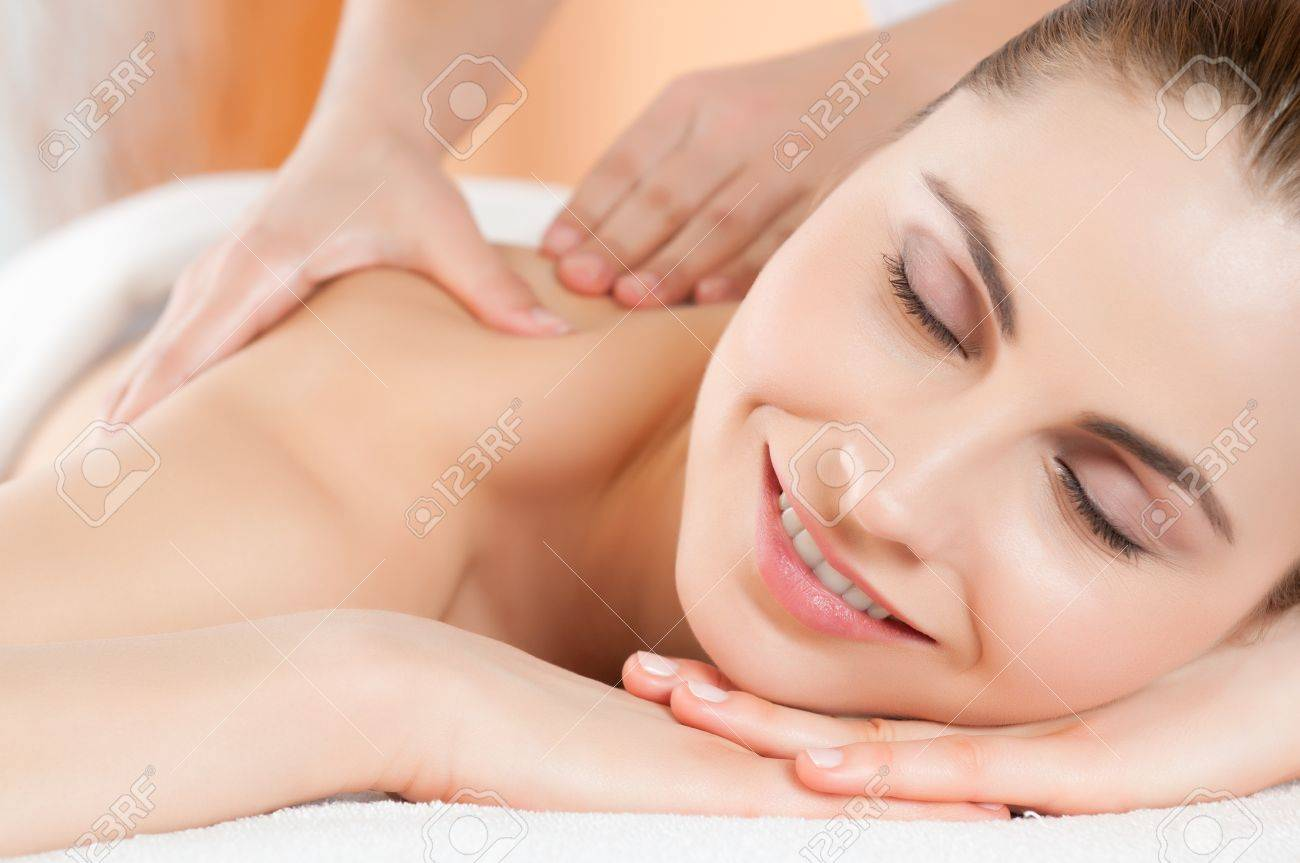 Beautiful young woman receiving hand massage on her back at beauty spa salon Stock Photo - 13741844