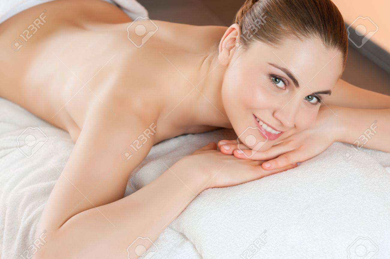 Beautiful young woman lying and relaxing at beauty spa center Stock Photo - 14262042