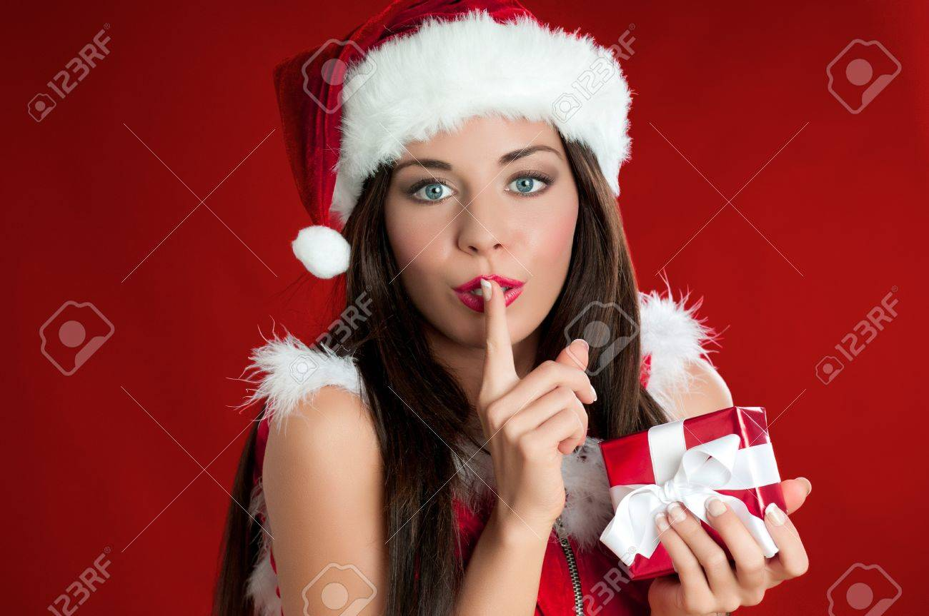 Santa Claus woman holding a present and carrying it secretly for Christmas Stock Photo - 15155145