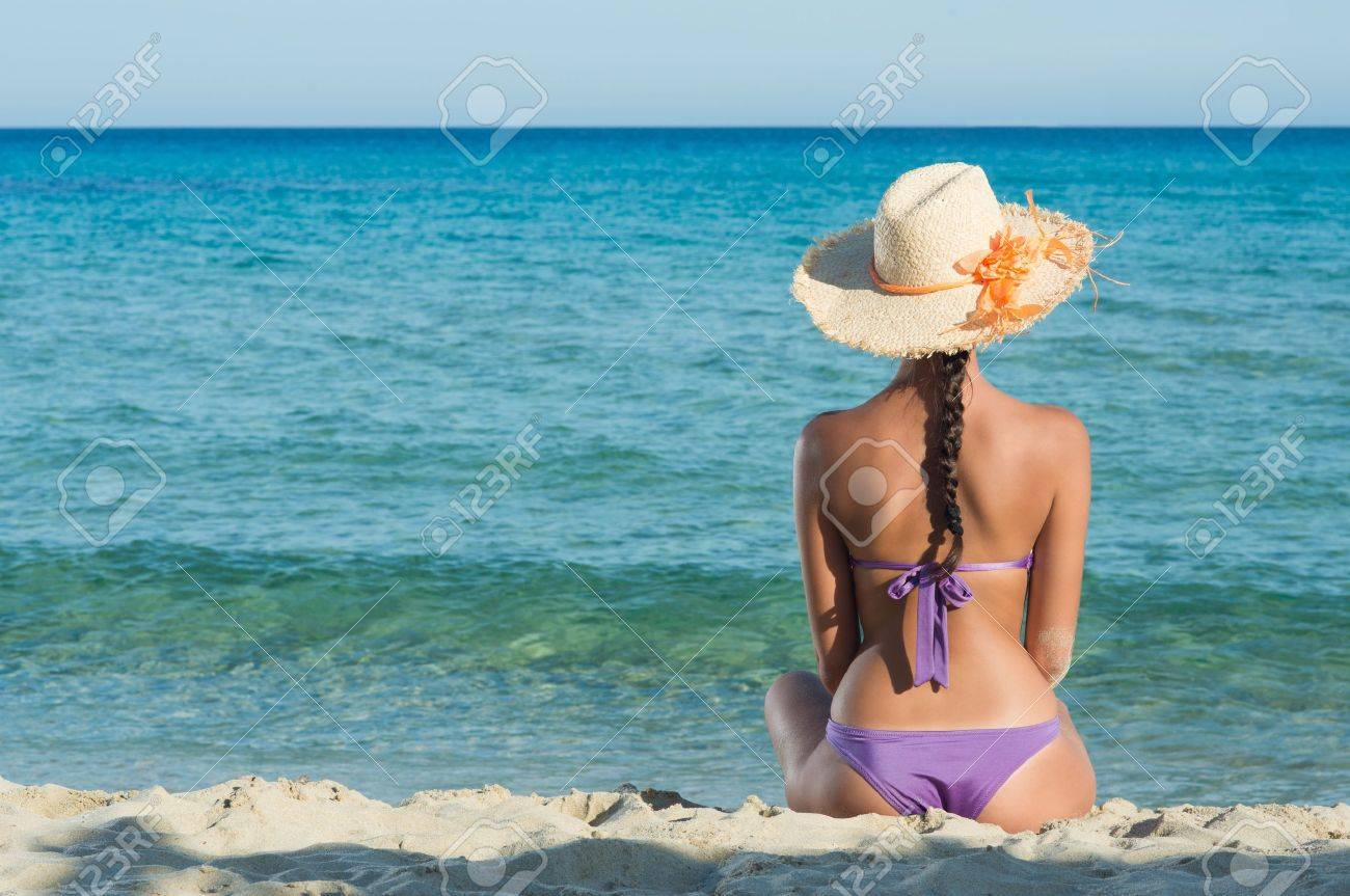 Young Woman Sitting And Looking At Sea Stock Photo - 17374446