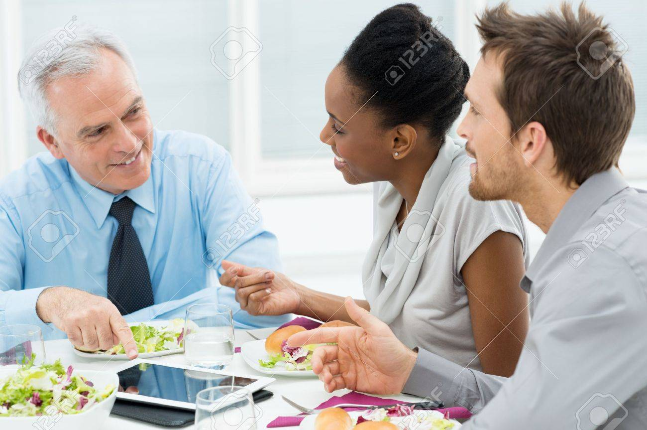 Business Colleagues Eating Meal Together While Discussing of Work Stock Photo - 19339639